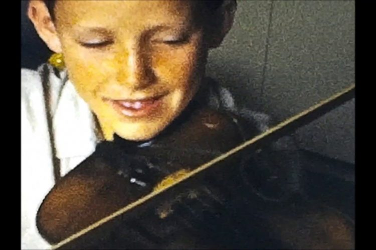 Lee Van Schaack Plays the Violin for His Family